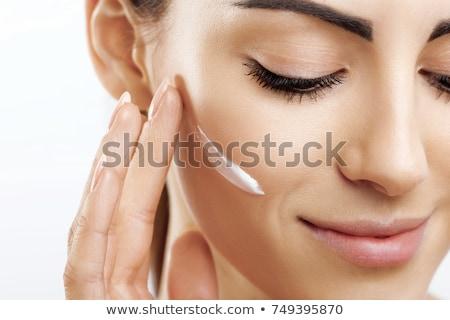 Female Applying Cosmetics To Her Face Stock photo © stuartmiles