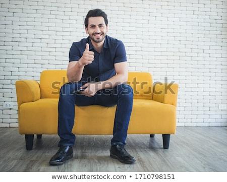 Man sitting on sofa Stock photo © photography33