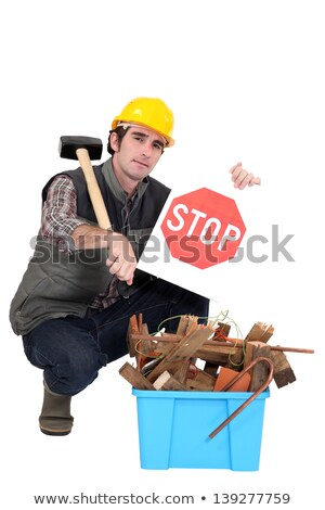 builder kneeling by recyclable waste stock photo © photography33