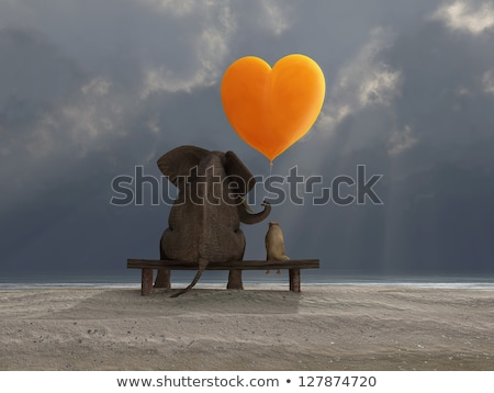 elephant and dog holding a heart shaped balloon stock photo © mike_kiev
