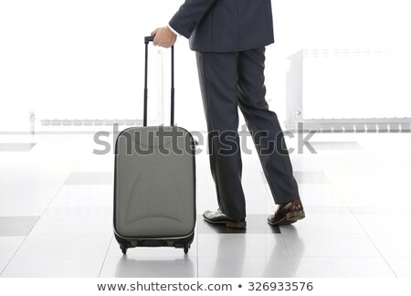 man holds suitcase & hand in pocket Stock photo © feedough