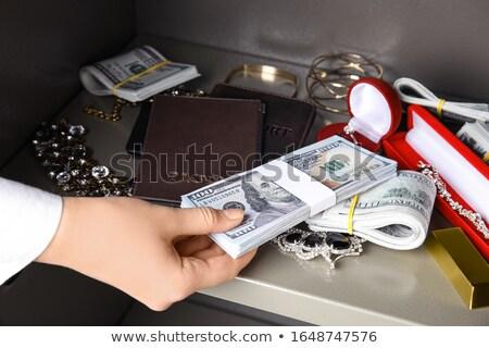 efectivo · poco · 100 · dólar · dinero · notas - foto stock © eldadcarin