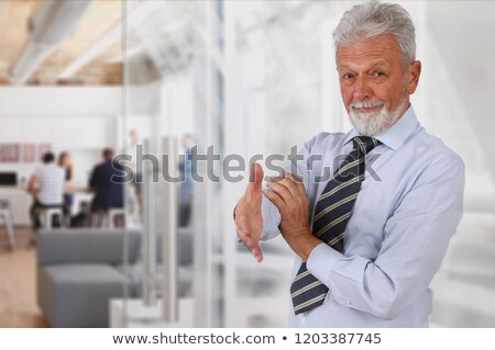 smiling old man ready to seal the deal stock photo © feedough