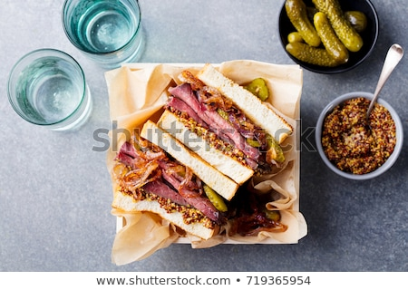 delicious pastrami club sandwich and pickles stock photo © juniart