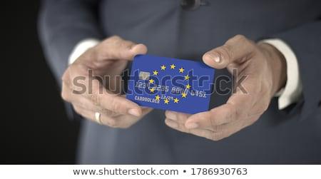 European Businessman holding business card with EU Flag Stock photo © stevanovicigor
