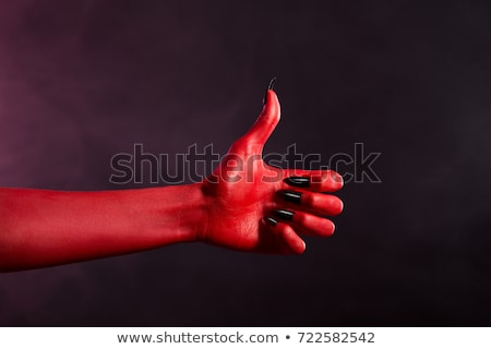 Spooky Red Devil Hand Showing Thumbs Up Stock fotó © Elisanth