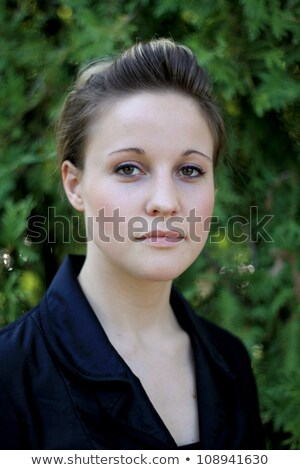 Serious Young Woman with Hair Pulled Back Stock photo © dash