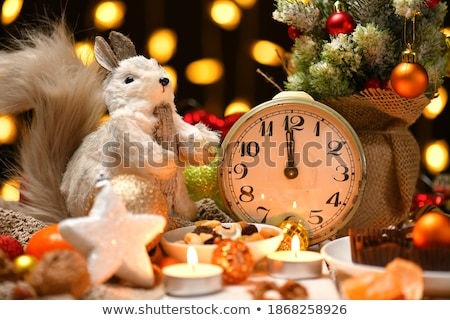 Stock photo: Christmas decoration with walnuts and squirrel