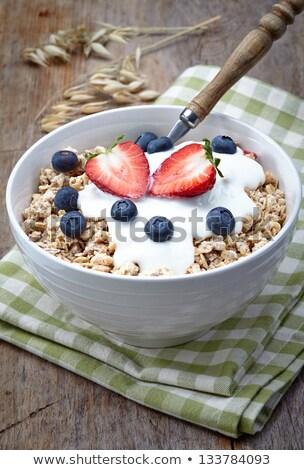Healthy breakfast of bran flakes with yogurt and strawberries Stock photo © raphotos