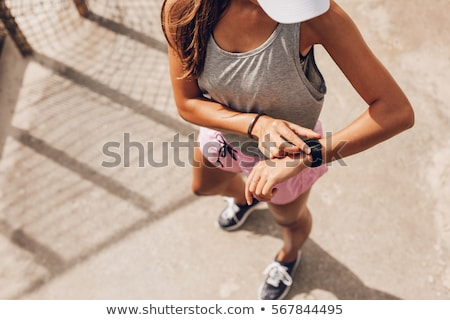 Fitness woman using fitness tracker  Stock photo © deandrobot