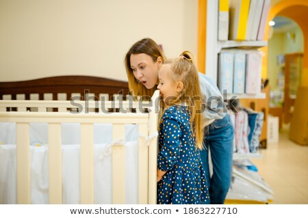family with little girl buy bedding in supermarket Stock photo © Paha_L