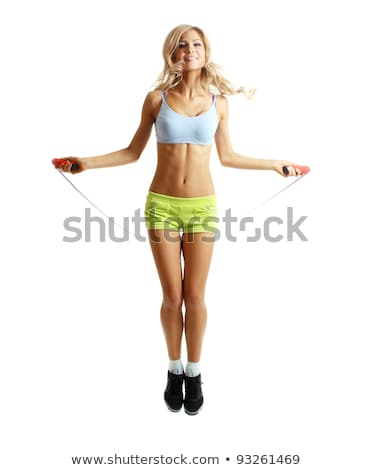 young pretty woman with skipping rope isolated on white Stock photo © iordani