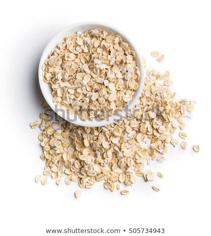 rolled oats on white wooden background stock photo © yelenayemchuk