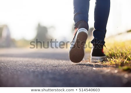 Close up of a male legs in sneakers standing Stock photo © deandrobot