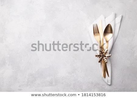 vintage silverware with christmas decorations stock photo © dariazu