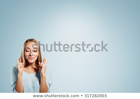 Cute young hopeful lady stock photo © deandrobot