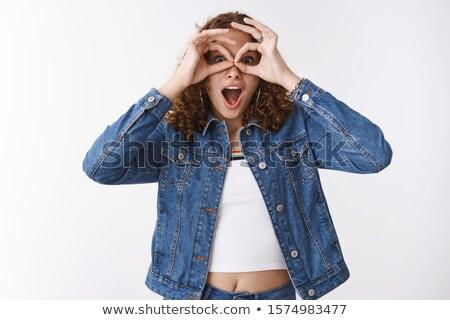 Meglepett vörös hajú nő lány néz látcső nő Stock fotó © konradbak