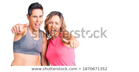 smiling couple in sport clothes showing thumbs up Stock photo © dolgachov