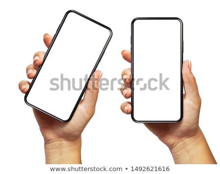 Mobiele telefoon vrouwelijke hand houten telefoon technologie Stockfoto © OleksandrO