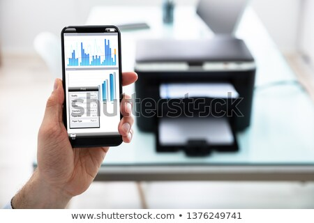 Man Holding Cellphone For Printing Graph Paper Stock photo © AndreyPopov