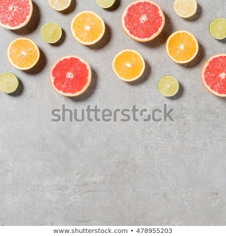 Stockfoto: Close Up Of Citrus Fruits On Stone Table