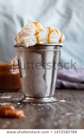 Cold Container of Vanilla Ice Cream with Salted Caramel Sauce  Stock photo © StephanieFrey