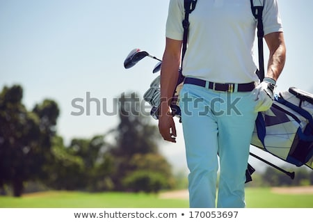 Men walking at golf course with bags. Stock photo © lichtmeister