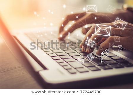 Emailing concept: At letter with woman and laptop. Stock photo © lichtmeister