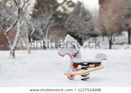 ребенка площадка оборудование покрытый снега игрушку Сток-фото © lovleah