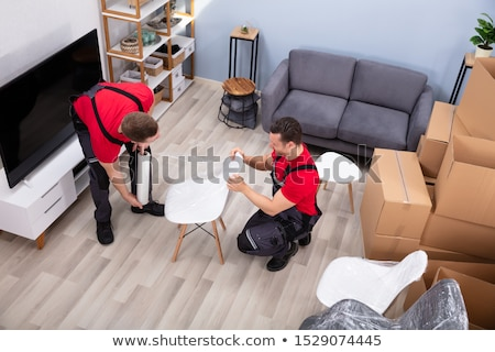 Movers Packing The Products In The Living Room Stock photo © AndreyPopov