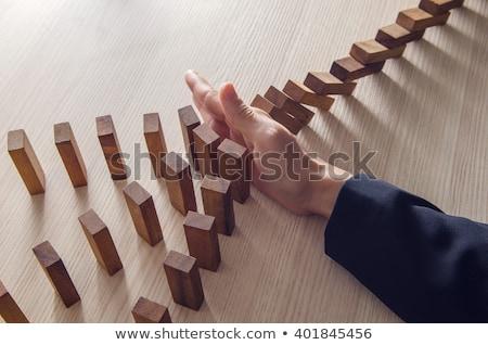 üzletasszony tömés hatás dominó közelkép üzletember Stock fotó © AndreyPopov
