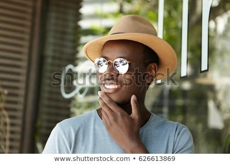 Bild jungen guy lächelnd anfassen Stock foto © deandrobot