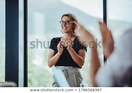 people applauding to colleague at office meeting Stock photo © dolgachov