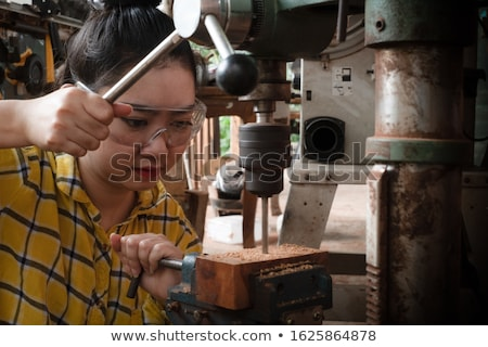 Beauty woman with auger  Stock photo © vladacanon