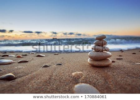 balanced cloudy rocks Stock photo © morrbyte