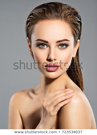 Gyönyörű fiatal felnőtt lány pózol stúdió fehér Stock fotó © pajgor