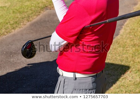 Stock photo: a golf ball on a red tee waiting to be hit