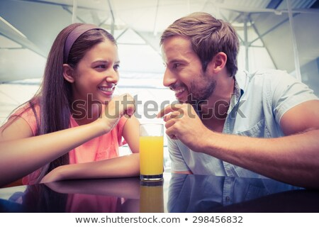 Couple sharing a glass of orange juice Stock photo © photography33