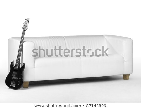 black bass guitar on white couch stock photo © prill