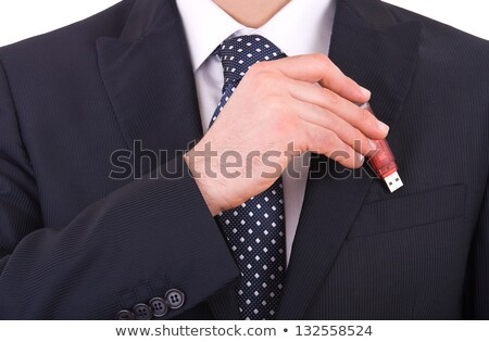 businessman putting a flash drive in his pocket stock photo © photography33