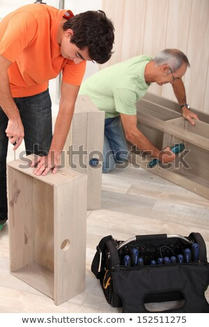 Grandfather and grandson assembling furniture Stock photo © photography33