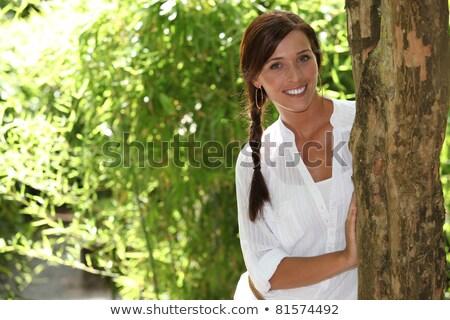 Woman stood touching tree Stock photo © photography33