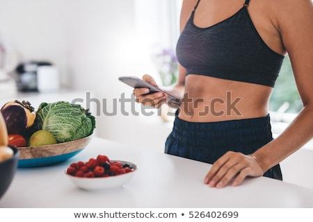 Kadın yeme meyve iç çamaşırı güzel genç kadın Stok fotoğraf © studiofi