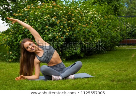 dark-haired woman posing in gym Stock photo © photography33