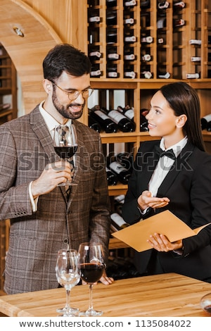 Wine steward showing a business card Stock photo © photography33