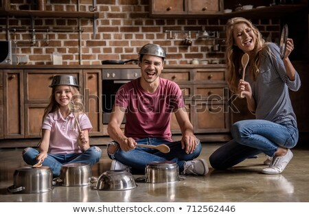 Playing drums with pots and pans Stock photo © sumners