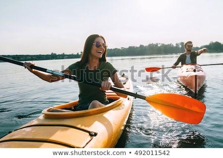 barbado · hombre · canoa · barco · lago · madera - foto stock © adrenalina