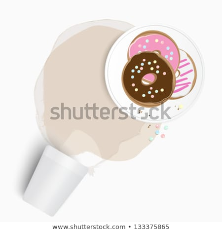 Fresh donuts with spilled tea or coffee stock photo © veralub