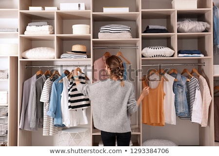 Ruhásszekrény portré fiatal nő hálószoba élet fehér Stock fotó © val_th
