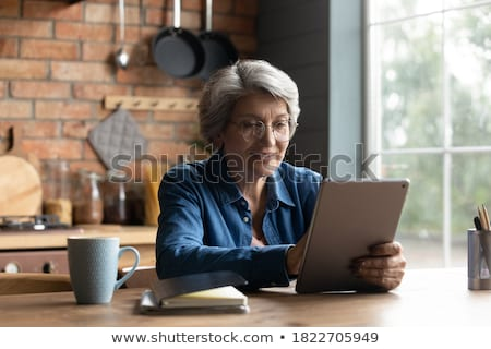 Woman Holding Tablet Stock photo © 805promo